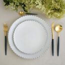 Costa Nova & Cutipol | Pearl White Plates & Goa Cutlery, Matte Gold, Blue Handle | Buy Online | Orpheu Decor